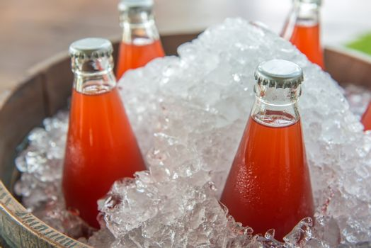 Strawberry juice bottle ice cold in the icebox