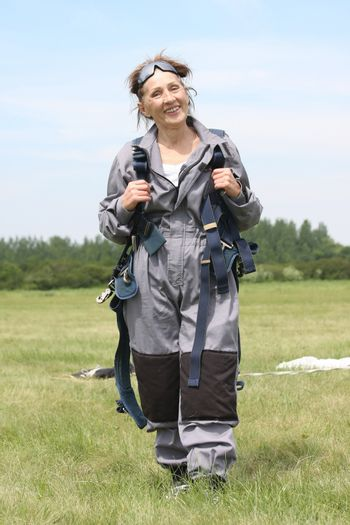 Happy woman posing after her first skydive