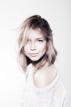 Studio portrait of attractive caucasian girl
