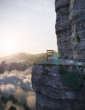 aerial view mountains with rock and chair concept photo