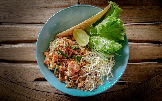 Thai food Pad thai on wood background.