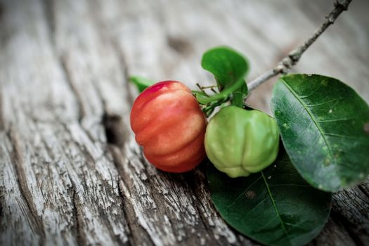 Acerola fruit on wood background