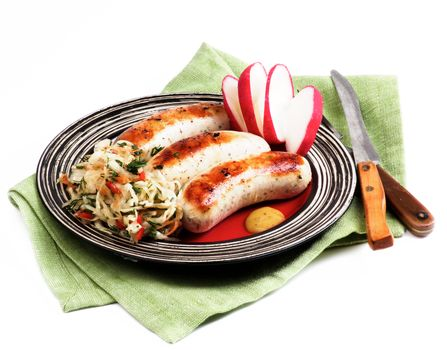 Delicious Grilled White Munich Sausages with Pickled Cabbage, Chopped Radish and Mustard Sauce on Red Striped Plate isolated on White background