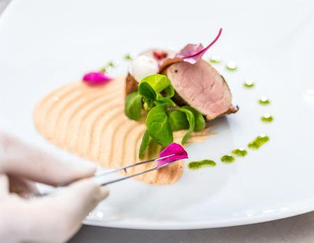 Chef decorating a dish