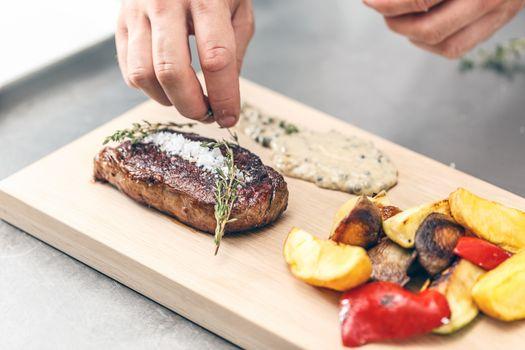 Chef serving beef steak
