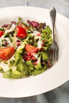 fresh salad with garlic cream sauce
