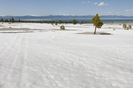 barren land with Mono Lake in distance, California