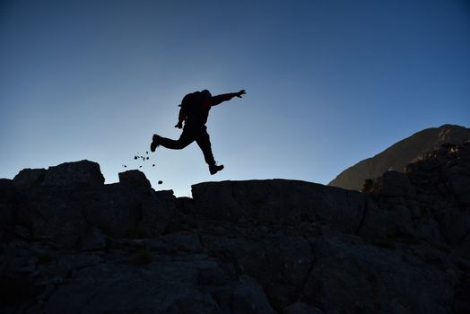 dynamic summit climber in the rocks