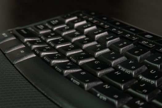 Keyboard with letters in Hebrew and English - Wireless keyboard - Close up