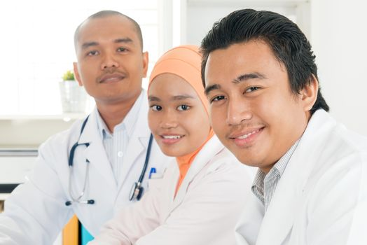 Happy Southeast Asian doctors