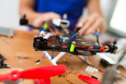 Man installing the component on drone body