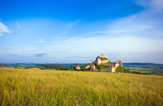 Old medieval fortress on top of the hill, Rupea village located