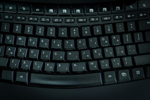 Keyboard with letters in Hebrew and English - Wireless keyboard - Top View -  Dark atmosphere