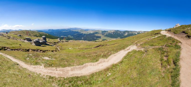 Panoramic view of Mount Bucegi on summer, part of the Carpathian Range from Romania