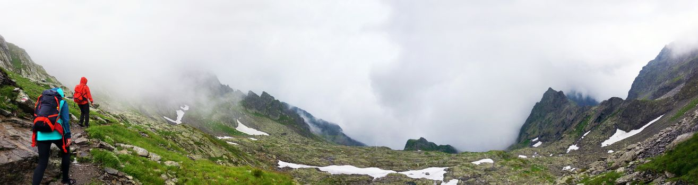 Panoramic view of FagarasHikers going to Negoiu peak on Fagaras Mountain part of the Carpathian Range, Romania