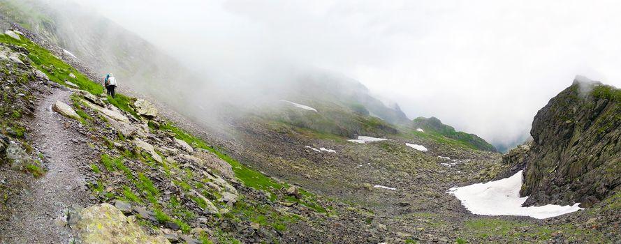 Hikers going to Negoiu peak part of Fagaras Mountain range, Romania