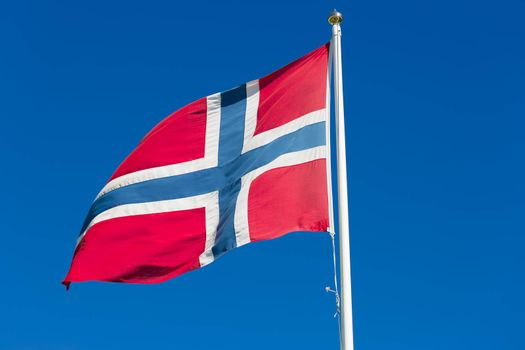 The Flag of Norway Waving in the Wind close up.