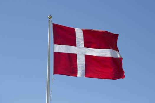 The Flag of Denmark Waving in the Wind close up.