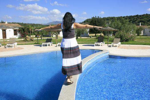 Girl walking over the swimming pool