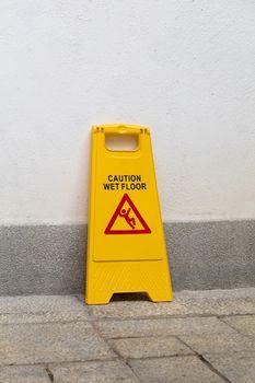 Yellow Warning Sign For Wet Floor