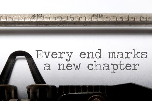 Every end marks a new chapter motivational saying printed on a typewriter