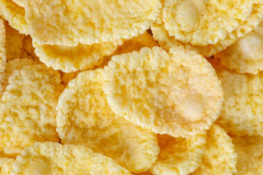 small heap of cornflakes, extreme closeup, macro, suitable as background