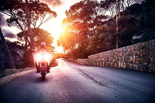 Motorcyclist in sunset light