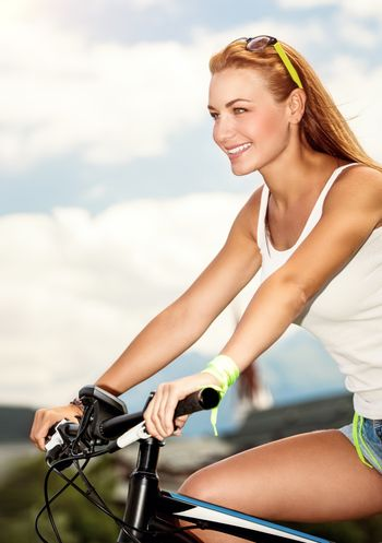 Beautiful woman on the bicycle