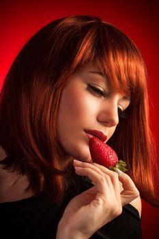 Seductive female with strawberry