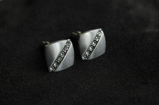 Silver cufflinks with precious stones