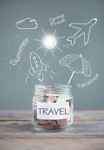 Jar of travel savings with sketches against a chalkboard