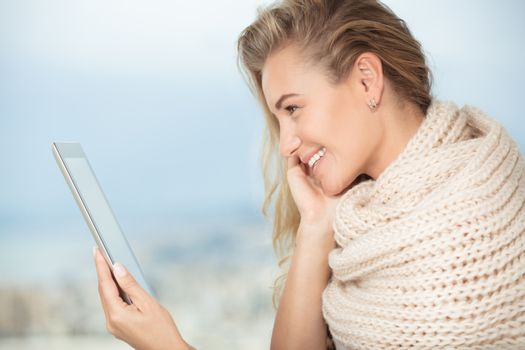 Portrait of a nice happy girl communicate with friends on the touchpad, using modern technology for communication with relatives from another countries