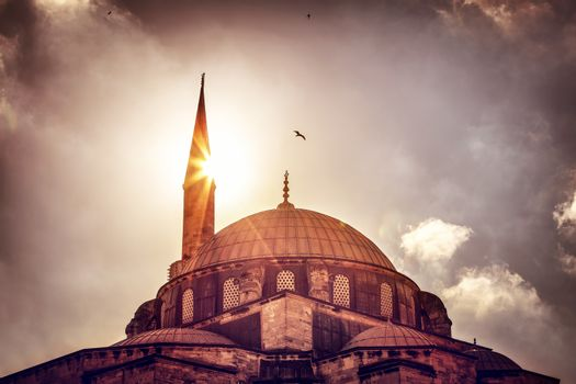 Mosque silhouette over sunset