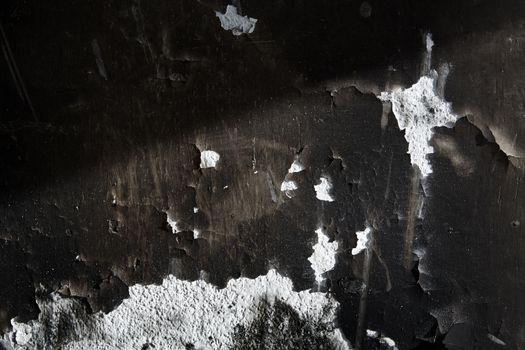 Old burned wall. Horizontal close-up photo