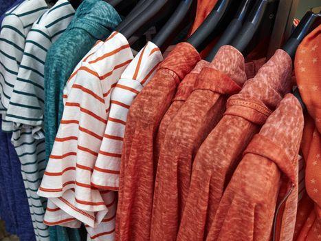 Fashionable blouses on hanger rack display