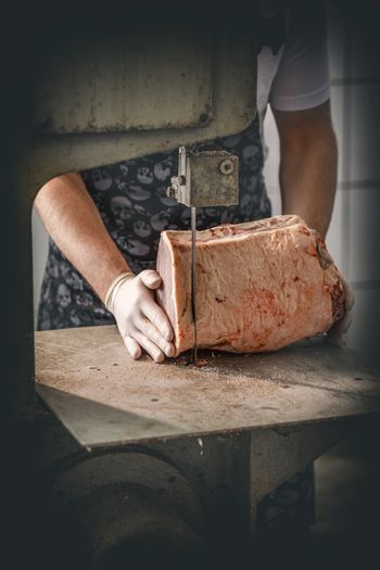 Butcher is cutting beef meat