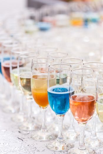 Many glasses of different alcohol