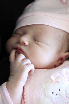 Sleeping newborn baby. The first days of life of the newborn girl