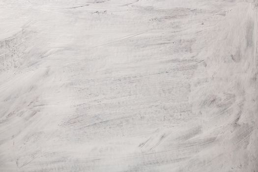 The texture of the paint is white. Wall background with plaster and stains. A screensaver or a postcard for a holiday.