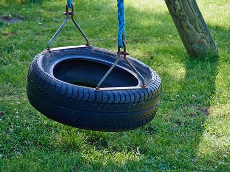 Tire swing hanging in a payground