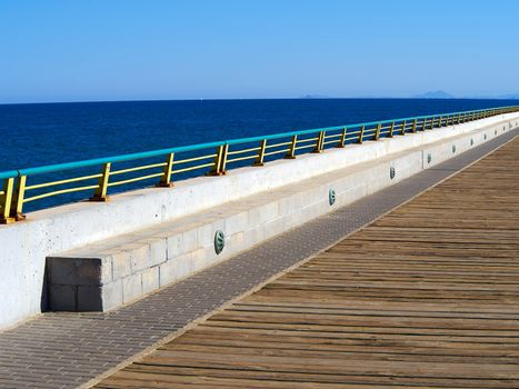 Beautiful beach seaside promenade with metal railings