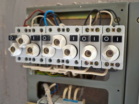 Electrical cabinet with old type fuses with wires