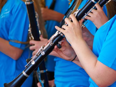 Young musician playing clarinet