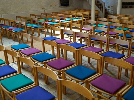 Simple wooden chairs in a church