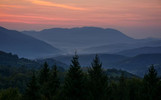 reddish sky at dawn in mountains