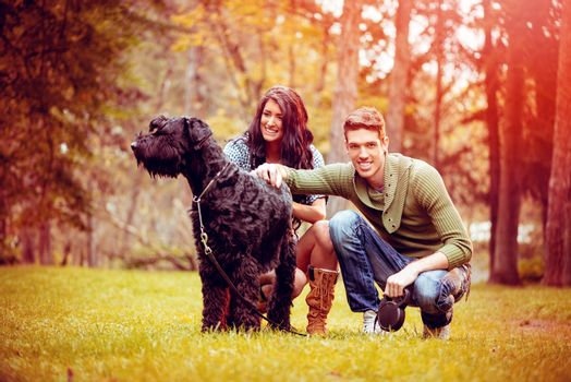 Young Couple With Schnauzer