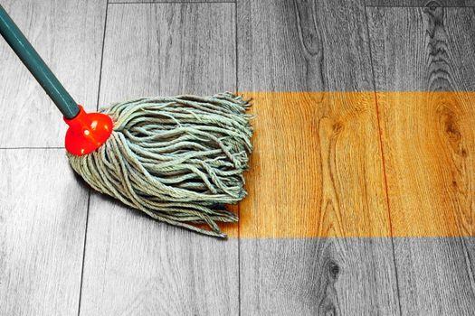 washing wooden floor with wet mop