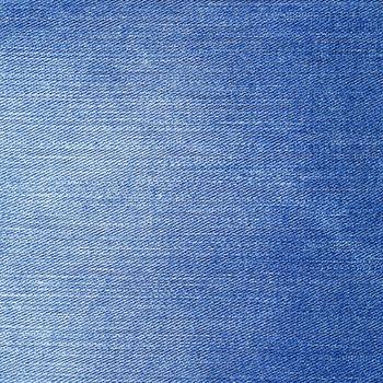 Denim texture. Light blue color jeans background.