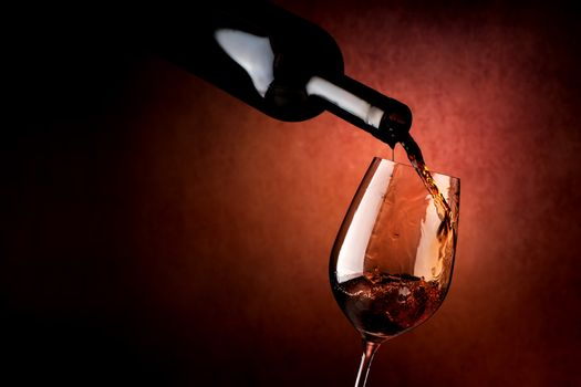 Wineglass on a brown background