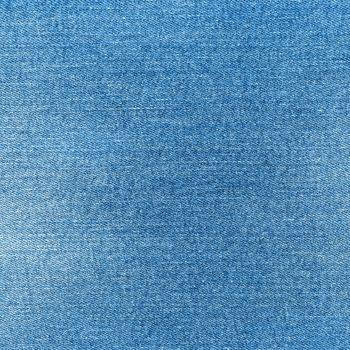 Denim texture. Light blue jeans. Fashion fabric